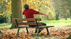Man relaxing on bench Stock Footage