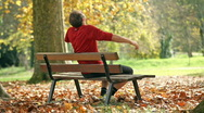 Stock Video Footage of man relaxing on bench