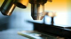Macro focusing microscope light background Stock Footage