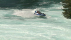 Jetboat approaches Huka Falls whitewater Stock Footage