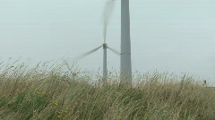 windmill turning fast, making electricity - stock footage