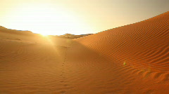 pan shot over dunes in sunset - stock footage