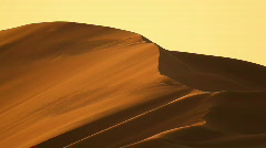Dunes in desert with wind closer Stock Footage