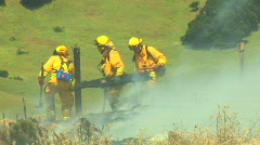 Firefighters Removing Debris Stock Footage