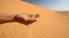 Sand running through fingers Stock Footage