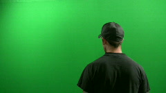 Man Gets Shot by a Gun In Front of a Green Screen Stock Footage