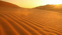 Loop sunset in dunes with sand blowing Stock Footage