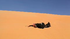 Desperate businessman in desert dunes thirsty part II Stock Footage