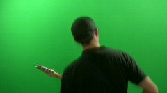 Playing the Guitar in front of a Green Screen Stock Footage