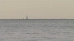 Nuclear submarine sub off beach coast guard fishing boat Stock Footage