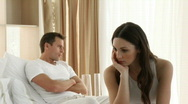 Upset couple on bed having an argument Stock Footage