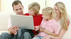 Happy family buying online at home Stock Footage