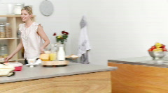 Parents and daughter in the kitchen after school Stock Footage