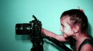 Happy little girl taking photos Stock Footage