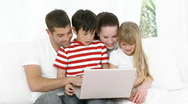 Happy Family at home borwing the net Stock Footage