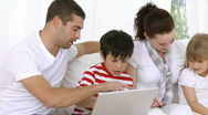Happy Family at home looking at a computer Stock Footage