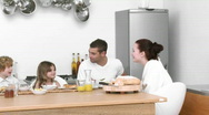 Family at home together eating breakfast Stock Footage