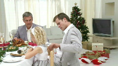 Family Sitting Down to Christmas Dinner - stock footage