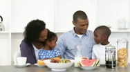 Afro-American parents and children having healthy breakfast Stock Footage