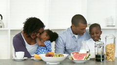 Afro-American family eating salad and fruit in the kitchen Stock Footage