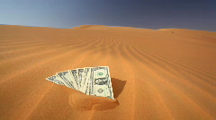 Money in sand - saying with dollars Stock Footage