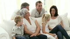 Family sitting on the sofa Stock Footage
