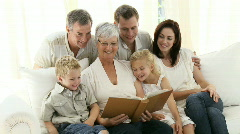 Grandparents with family at home Stock Footage