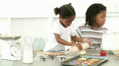 Afro-American brother and sister baking - stock footage