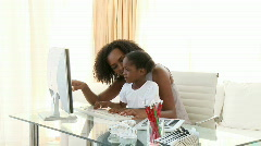 Afro-American mother and daugter using a computer - stock footage
