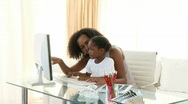 Stock Video Footage of Afro-American mother and daugter using a computer