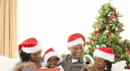 Panorama of Afro-American family with Christmas gifts on the sofa Stock Footage