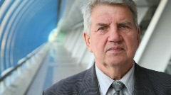 portrait of senior man in suite in building - stock footage