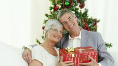 Happy Grandparents holding christmas presents Stock Footage