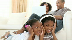 Afro-American children listening to the music at home Stock Footage