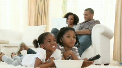 Afro-American children watching a film at home - stock footage