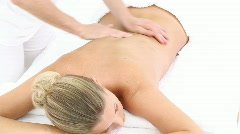 Woman lying on massage table at spa Stock Footage