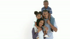 Afro-American parents giving their children piggyback rides Stock Footage