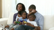 Afro-American family playing video games Stock Footage