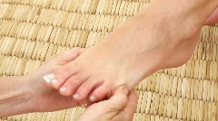 Womans feet being massaged Stock Footage