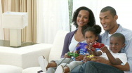 Afro-American family playing video games at home Stock Footage