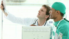 Surgeon and Doctor looking at an xray - stock footage