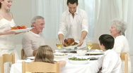 Family preparing food for their Christmas dinner and tasting with wine Stock Footage