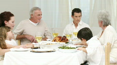Family talking at their Christmas dinner Stock Footage