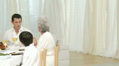 Panorama of family talking at their Christmas dinner - stock footage