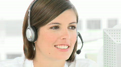Businesswoman talking on a headset in the office Stock Footage