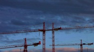 Stock Video Footage of Construction cranes cloudy stormy Crisis Risk and Chance