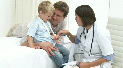 Father and Son visiting a doctor Stock Footage