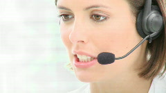 Close-up of beautiful woman working in a call center Stock Footage