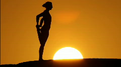 Woman stretching in sunset Stock Footage