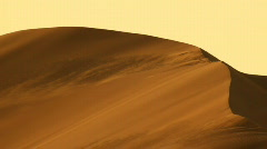 heavy wind on dune in desert - stock footage